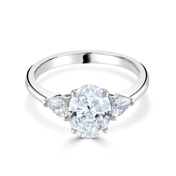 Oval Cut Three Stone Platinum Diamond Ring