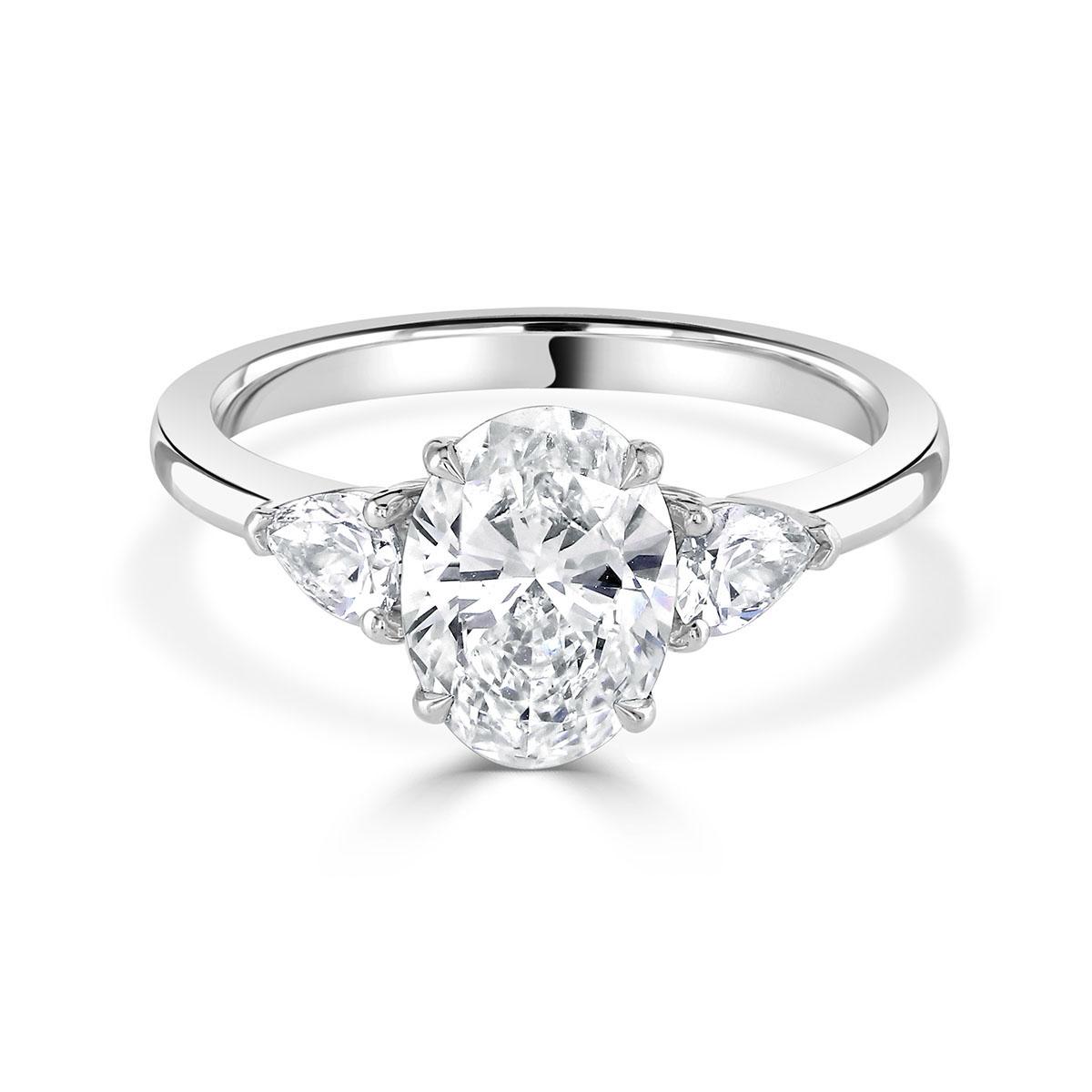 Oval Cut Platinum Trilogy Ring