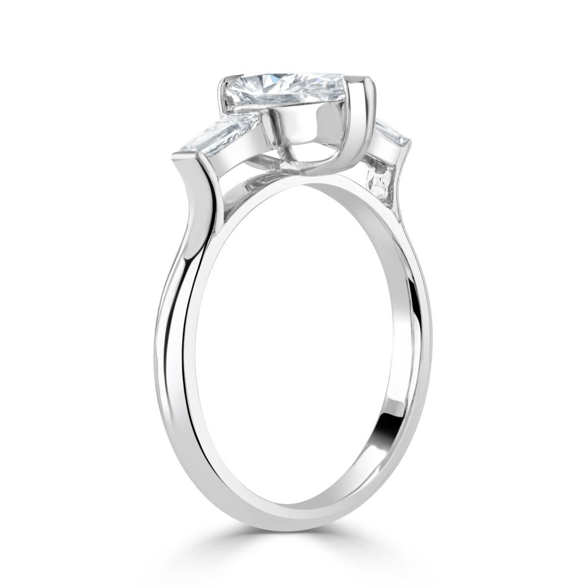 Pear Cut Three Stone Platinum Diamond Ring